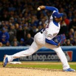 FILE - In this Oct. 30, 2016, file photo, Chicago Cubs relief pitcher Aroldis Chapman throws during the seventh inning of Game 5 of the Major League Baseball World Series against the Cleveland Indians, in Chicago. Chapman reached agreement to return to the New York Yankees on Wednesday, Dec. 7, with the highest-priced contract ever for a relief pitcher, an $86 million deal for five years, a person familiar with the negotiations told The Associated Press. (AP Photo/Nam Y. Huh, File)