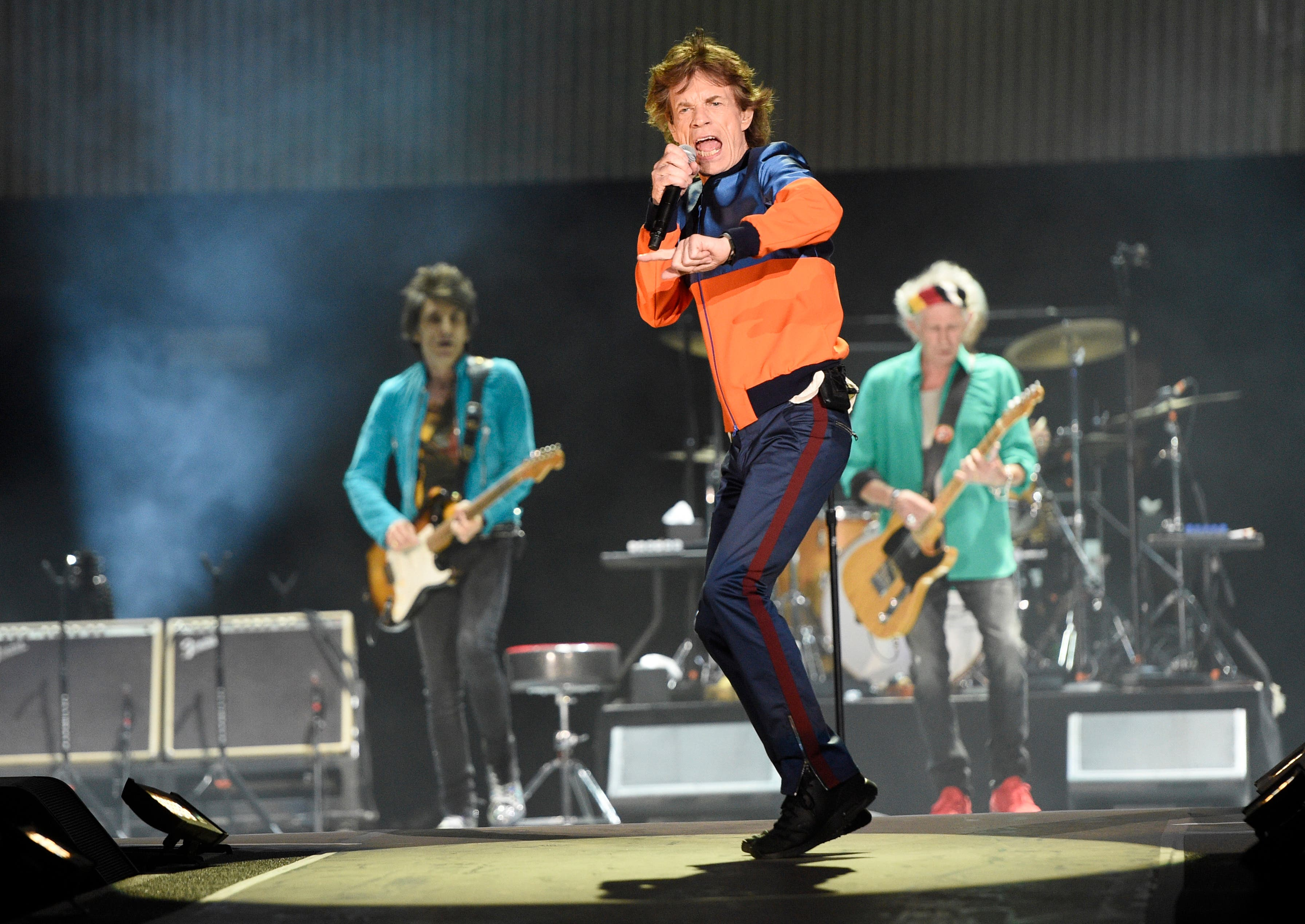 "FILE - In this Oct. 7, 2016 file photo, Mick Jagger, center, performs with Ron Wood, left, and Keith Richards of the Rolling Stones during their performance on day 1 of the 2016 Desert Trip music festival at Empire Polo Field in Indio, Calif.  Jagger, the 73-year-old frontman of the Rolling Stones, was on hand Thursday, Dec. 8, 2016 at a New York hospital when girlfriend, Melanie Hamrick, gave birth to the couple's son. According to a statement, both parents are ""delighted"" and ""mother and baby are doing well.""(Photo by Chris Pizzello/Invision/AP)"