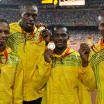 Michael Fraser, Usain Bolt, Nesta Carter y Asafa Powell . AP
