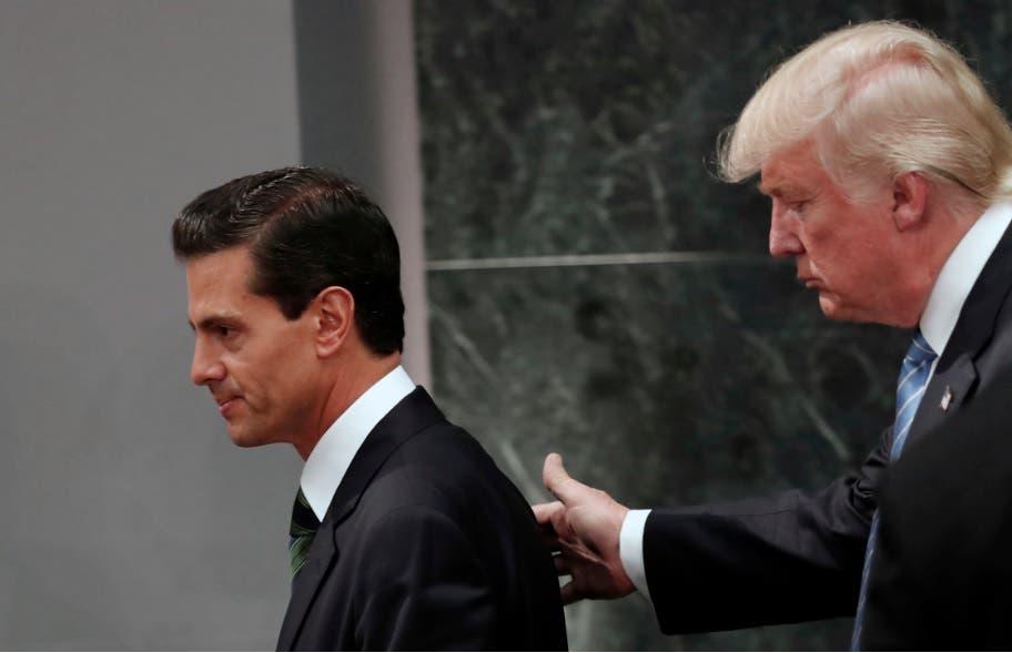Trump y Peña Nieto buscan reducir tensión bilateral