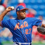 El pitcher dominicano de los Mets de Nueva York, J. (AP Photo/John Bazemore)