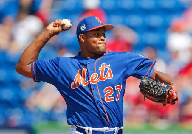 El pitcher dominicano de los Mets de Nueva York, J. (AP Photo/John Bazemore)
