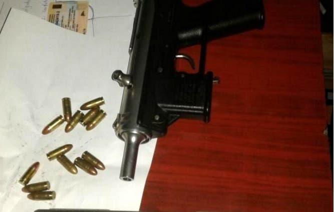 Arma usada por el agente municipal para disparar.