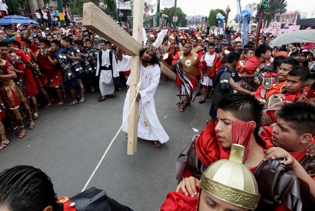 Penitents participate in a re-enactment of the crucifixion of Jesus Christ on Good Friday in Iztapalapa in Mexico City