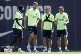Piqué, Mascherano y Aleix Vidal viajan a Madrid con el alta médica