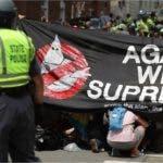 Manifestantes de ambos bandos gritaban insultos y consignas/AFP