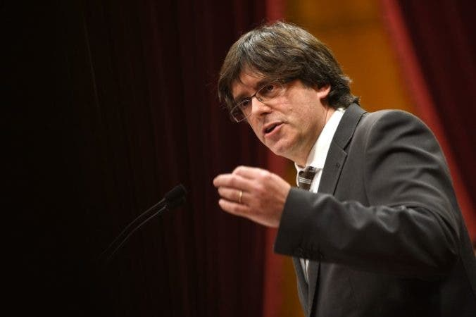 Current mayor of Gerona and candidate for the Catalan Government's presidency Carles Puigdemont speaks during an investiture debate for the Catalan Government's presidency, at the Parliament of Catalonia in Barcelona on January 10, 2016. Carles Puigdemont, the man who has been chosen to lead Catalonia to independence from Spain, called today for the secession process to start in a speech to the wealthy region's parliament. AFP PHOTO/ LLUIS GENE / AFP / LLUIS GENE        (Photo credit should read LLUIS GENE/AFP/Getty Images)