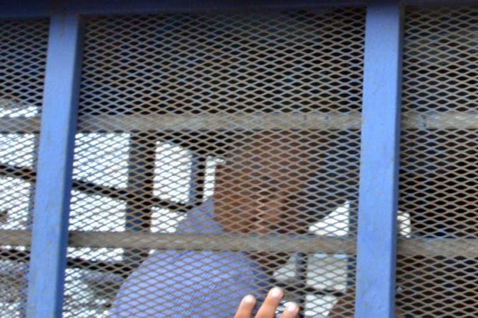 Caso asesinato del abogado Yuniol Ramírez salida de acusado en interrogado en la sala digital del departamento criminal  de Palacio Policías.  Fotos: José Adames Arias.