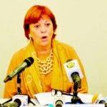 Representante regional de Unicef, María Cristina Perceval, en el centro, expone sobre informe Niñas.