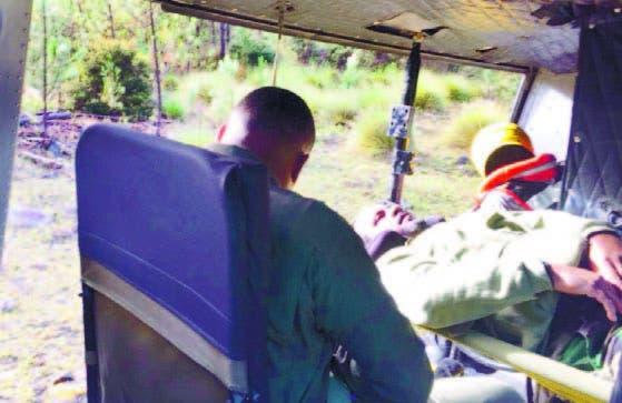 Amador Espinosa cuando era trasladado en helicóptero.
