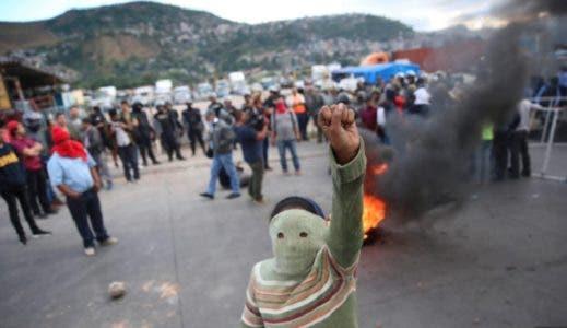 Gobierno hondureño denuncia Venezuela y FARC estarían financiando protestas