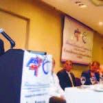 El presidente de la Federación Dominicana de Comerciantes (FDC), Iván de Jesús García, pronuncia un discurso durante un desayuno en conmemoración de su 43 aniversario.