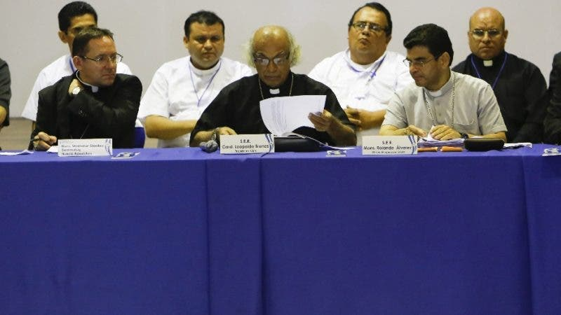 Cardinal Leopoldo Brenes, center, reads a statement accompanied by leaders of the Roman Catholic Church during talks between the opposition and the government, in Managua, Nicaragua, Friday, June 15, 2018. The negotiations had been suspended since May 23 due to a lack of progress, but resumed again Friday between business, student, civil society and farmers' groups and representatives of President Daniel Ortega's government. (AP Photo/Alfredo Zuniga)