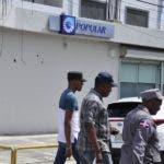 El pais.Graficas del Banco Popular donde  hubo un  asalto en la sucursal del Híper Uno de ensanche Isabelita.Hoy/Pablo Matos        28-06-2018