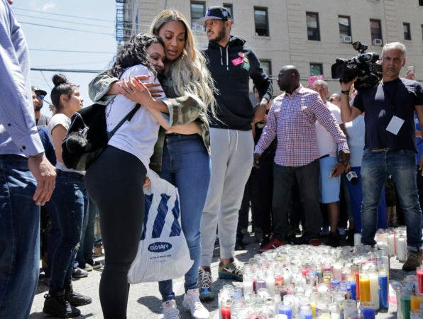 5. Former New York Knick Carmelo Anthony, third from left, his wife La La Anthony, second from left, and an unidentified woman visit a memorial to Lesandro Guzman-Feliz near the site of his murder in the Bronx borough of New York, Monday, June 25, 2018. Several suspects are in custody in New Jersey and awaiting extradition in connection with last week's killing of the 15-year-old boy in the Bronx that has sparked community outrage. Police said that Guzman-Feliz's death was gang related. The teen was attacked outside a bodega by a group of men and died after getting slashed in the neck with a machete. (AP Photo/Seth Wenig)