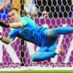 Russia goalkeeper Igor Akinfeev saves a penalty by Spain's Koke during the round of 16 match between Spain and Russia at the 2018 soccer World Cup at the Luzhniki Stadium in Moscow, Russia, Sunday, July 1, 2018. (AP Photo/Matthias Schrader)