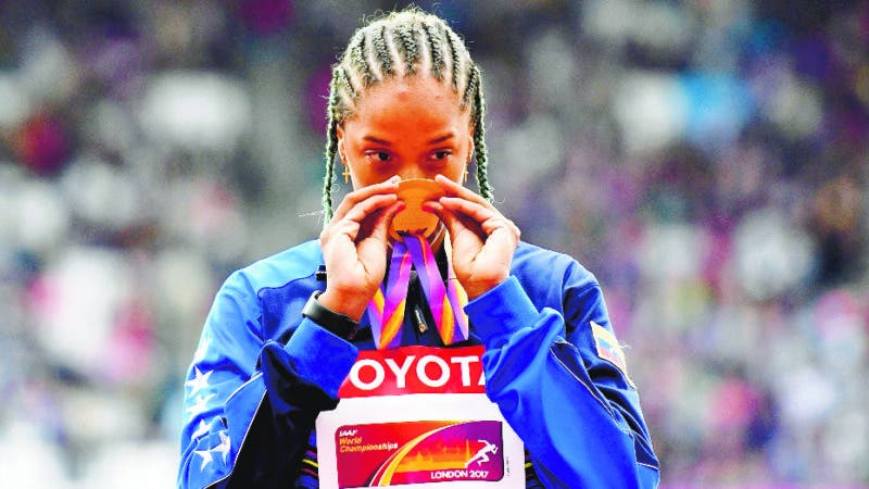 Women's triple jump gold medalist Venezuela's Yulimar Rojas celebrates on the podium following the medal ceremony at the World Athletics Championships in London Tuesday, Aug. 8, 2017. (AP Photo/Martin Meissner)