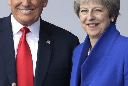 U.S. President Donald Trump, left, talks to British Prime Minister Theresa May during a summit of heads of state and government at NATO headquarters in Brussels Wednesday, July 11, 2018. NATO leaders gather in Brussels for a two-day summit to discuss Russia, Iraq and their mission in Afghanistan. (AP Photo/Markus Schreiber)
