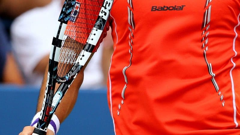 NEW YORK, NY - AUGUST 30: Victor Estrella Burgos of the Dominican Republic reacts against Milos Raonic of Canada during their men's singles third round match on Day Six of the 2014 US Open at the USTA Billie Jean King National Tennis Center on August 30, 2014 in the Flushing neighborhood of the Queens borough of New York City.   Al Bello/Getty Images/AFP == FOR NEWSPAPERS, INTERNET, TELCOS & TELEVISION USE ONLY ==