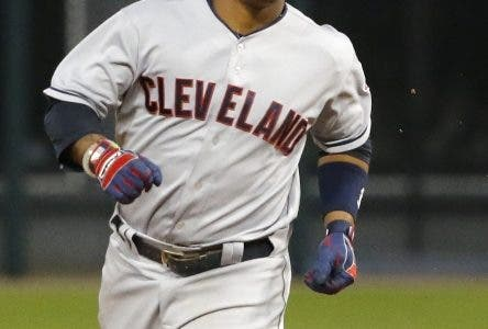 Cleveland Indians' Jose Ramirez rounds the bases after hitting a home run off Chicago White Sox starting pitcher Erik Johnson during the second inning of the second baseball game of a double header Monday, May 23, 2016, in Chicago. (AP Photo/Charles Rex Arbogast)