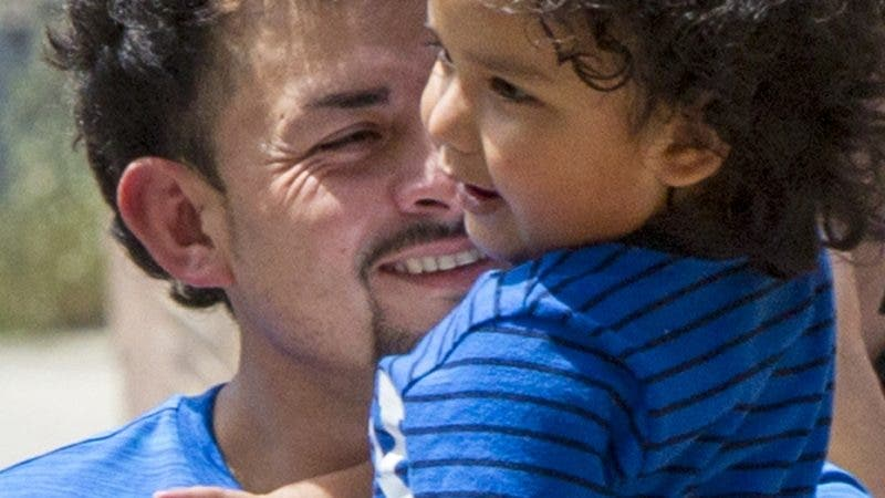Ever Reyes Mejia is reunited with his 3-year-old son at the U.S. Immigration and Customs Enforcement (ICE) office building in Grand Rapids, Mich., on Tuesday, July 10, 2018. More than 2,000 children were reportedly separated from their parents after crossing the Southern U.S. border as part of an immigration strategy by the Trump administration. (Cory Morse/The Grand Rapids Press via AP)