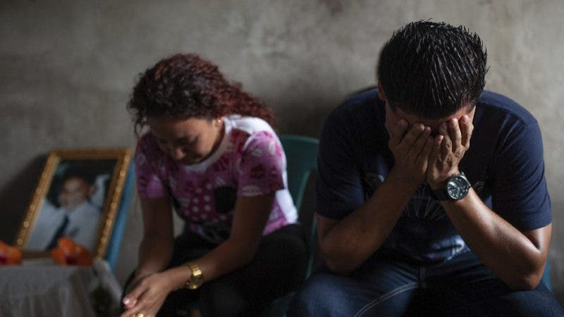 Relatives and friends mourn Bryan Picado at his wake after he was killed when police and paramilitaries attacked a barricade at the Sandino neighborhood of Jinotega, Nicaragua, Tuesday, July 24, 2018. Four more people have been killed in Nicaragua amid unrest that has rocked the country for over three months. AP Photo/Cristobal Venegas)