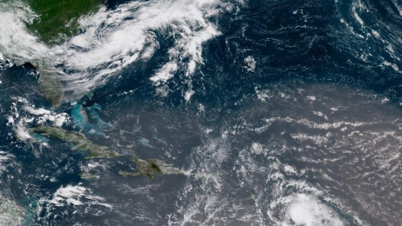 In this geocolor image GOES-16 satellite image taken Sunday, July 8, 2018, at 15:00 UTC, shows Tropical Storm Beryl, center right, moving across the Lesser Antilles in the eastern Caribbean Sea, and Tropical Storm Chris, top left, off the U.S. East Coast. (NOAA via AP)