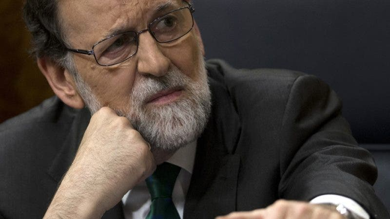 FILE - In this file photo dated Thursday, May 31, 2018, Spain's Prime Minister Mariano Rajoy and Popular Party leader listens to speeches during the first day of a motion of no confidence session at the Spanish parliament in Madrid.  Former Spanish prime minister and veteran politician Mariano Rajoy on Friday July 20, 2018, vowed loyalty to his Popular Party in an emotional farewell. (AP Photo/Francisco Seco, FILE)