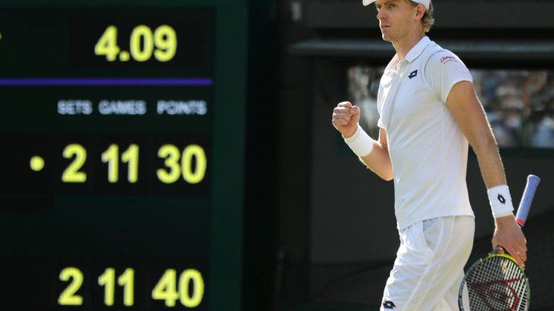Kevin Anderson of South Africa celebrates winning his men's quarterfinals match against Switzerland's Roger Federer, at the Wimbledon Tennis Championships, in London, Wednesday July 11, 2018. (AP Photo/Ben Curtis)
