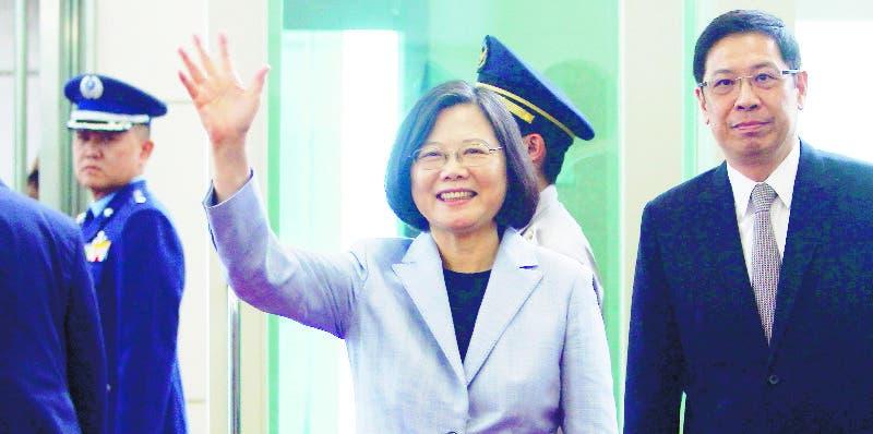 Taiwanese President Tsai Ing-wen waves to the media as she departs for Latin America at Taoyuan International Airport in Taoyuan, Taiwan, Sunday, Aug. 12, 2018. (AP Photo/Chiang Ying-ying)