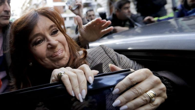 Former President Cristina Fernandez gets into a car to be transported to court, in Buenos Aires, Argentina, Monday, Aug. 13, 2018. Fernandez is expected to give testimony as part of a corruption probe sparked by the recent release of an investigation on illicit dealings during the governments of the ex-president and her late husband and predecessor, Nestor Kirchner.  (AP Photo/Natacha Pisarenko)