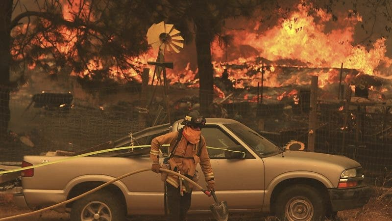 The Ranch Fire spots out ahead of the main fire in Spring Valley, burning two homes, Monday, Aug. 6, 2018, during the battle to stop the spread of the massive fire in California's Lake County. (Kent Porter/The Press Democrat via AP)