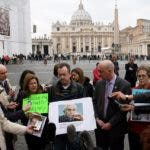 CORRECTING DATEPeter Isely (R), John Pilmaier (C) and Barbara Blaine (R), all of the US organisation SNAP (Survivors Network of those Abused by Priests), hold up a picture of Pope benedict XVI on March 25, 2010 as they take part in a demonstration against child sexual abuse, in front of St. Peter's Square at the Vatican. The Vatican is engaging in a vigorous defence of Pope Benedict XVI after a new set of revelations emerged alleging he failed to act to stop a child-molesting US priest. The Roman Catholic Church's morals watchdog was headed by Benedict, then a cardinal, when it was warned about Reverend Lawrence Murphy, who was accused of abusing up to 200 deaf children between 1950 and 1974. The case follows a long series of sex abuse scandals involving priests, and for the Catholic faithful, it is having an destructive impact on their community.AFP PHOTO / STR