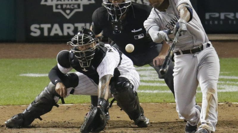 New York Yankees' Miguel Andujar hits a single off of Chicago White Sox relief pitcher Luis Avilan during the 13th inning of a baseball game Tuesday, Aug. 7, 2018, in Chicago. (AP Photo/Annie Rice)