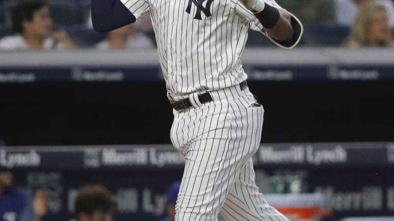 New York Yankees' Miguel Andujar reacts as he heads down the third base line after hitting a two-run home run against the Texas Rangers during the fourth inning of a baseball game, Thursday, Aug. 9, 2018, in New York. (AP Photo/Julie Jacobson)
