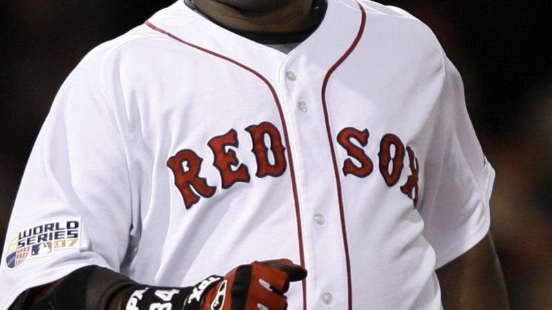 Boston Red Sox's David Ortiz reacts after flying out to center field to end the inning with two men on in the sixth inning during Game 2 of the baseball World Series against the Colorado Rockies Thursday, Oct. 25, 2007, at Fenway Park in Boston. (AP Photo/Winslow Townson)
