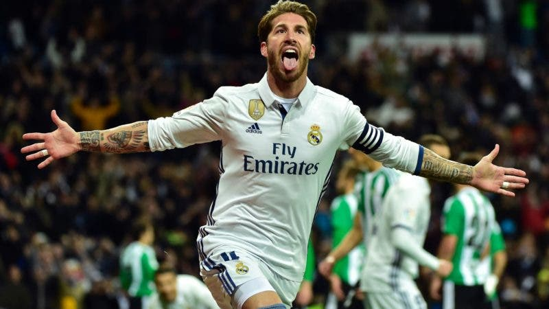 TOPSHOT - Real Madrid's defender Sergio Ramos celebrates after scoring a goal during the Spanish league footbal match Real Madrid CF vs Real Betis at the Santiago Bernabeu stadium in Madrid on March 12, 2017. / AFP / GERARD JULIEN