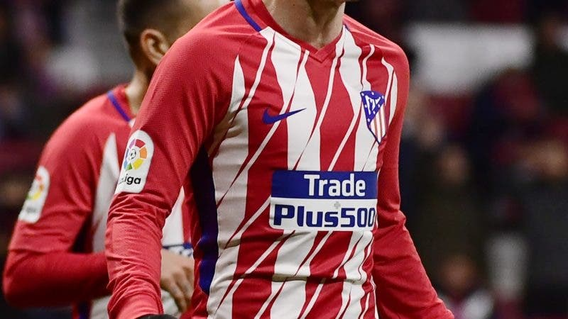 Atletico Madrid's French forward Antoine Griezmann celebrates his fourth goal during the Spanish league football match Club Atletico de Madrid against Club Deportivo Leganes SAD at the Wanda Metropolitano stadium in Madrid on February 28, 2018. / AFP / PIERRE-PHILIPPE MARCOU