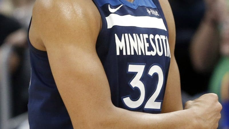 Minnesota Timberwolves' Karl-Anthony Towns celebrates his three-point basket in the second half of an NBA basketball game against the Golden State Warriors, Sunday, March 11, 2018, in Minneapolis. (AP Photo/Jim Mone)
