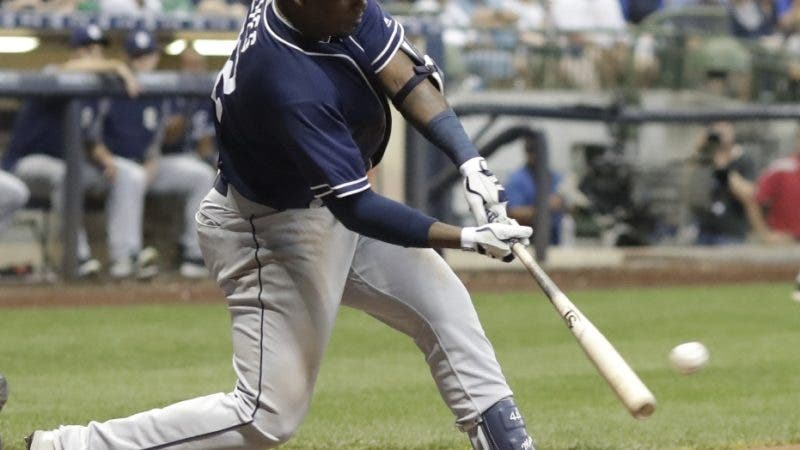 San Diego Padres' Franmil Reyes hits a two-run scoring double during the seventh inning of a baseball game against the Milwaukee Brewers Tuesday, Aug. 7, 2018, in Milwaukee. (AP Photo/Morry Gash)