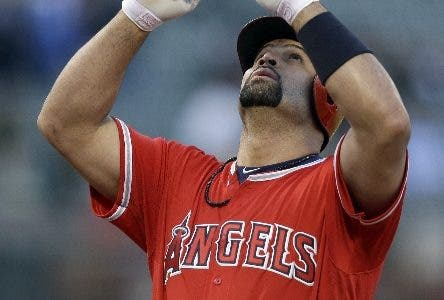 Los Angeles Angels' Albert Pujols celebrates after hitting a home run off Oakland Athletics' Jharel Cotton in the first inning of a baseball game Tuesday, May 9, 2017, in Oakland, Calif. (AP Photo/Ben Margot)
