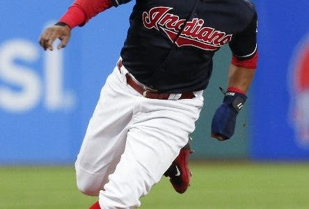 Cleveland Indians' Jose Ramirez rounds third base on the way to scoring on a single by Edwin Encarnacion during the first inning in a baseball game against the Minnesota Twins, Wednesday, Sept. 27, 2017, in Cleveland. (AP Photo/Ron Schwane)