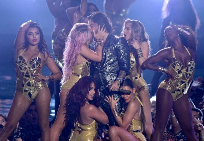 7. Maluma, center right, kisses a dancer as he performs at the MTV Video Music Awards at Radio City Music Hall on Monday, Aug. 20, 2018, in New York. (Photo by Chris Pizzello/Invision/AP)