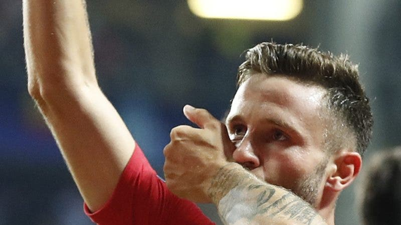Atletico's Saul Niguez celebrates after scoring his side's third goal during the UEFA Super Cup final soccer match between Real Madrid and Atletico Madrid at the Lillekula stadium in Tallinn, Estonia, Wednesday, Aug. 15, 2018. (AP Photo/Mindaugas Kulbis)