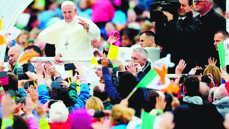 Pope Francis waves to the crowd as he arrives to celebrate the closing Mass at the World Meeting of Families at Phoenix Park in Dublin, as part of his visit to Ireland, Sunday, Aug. 26, 2018. (Brian Lawless/PA via AP)