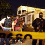 Mexican police guard the area surrounding the scene of murder, outside a drug treatment center in Ciudad Juarez, on September 3, 2009. A surge in drug-related violence the last 24 hours has seen at least 40 people killed in the troubled northern border region and President Felipe Calderon's home state. At least 18 people were killed and five wounded late August 2 when gunmen stormed into a drug treatment center in northern Mexico's violence-plagued Ciudad Juarez. Civil protection officials warned there might be more victims from the shootout. The city lies just across the border from El Paso, Texas, where feuding drug cartels are engaged in a violent struggle. AFP PHOTO/ Jesus ALCAZAR