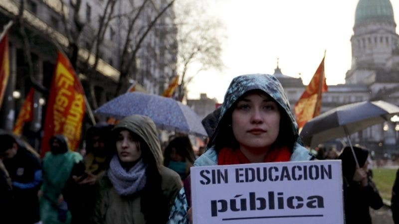 "A protester holds the Spanish sign ""Without public education there is no future"" during a march to Plaza de Mayo in Buenos Aires, Argentina, Thursday, Aug. 30, 2018. People are demonstrating in support of public University, demanding salary raises for teachers and more public investment in higher level education. (AP Photo/Natacha Pisarenko)"