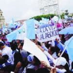 People take part in an anti-abortion march Sunday, Sept. 2, 2018, that ended at the Plaza de la Constitucion in Guatemala City. The march was in support of a new bill that expands the criminalization of abortion and could subject women who have miscarriages to prosecution. The proposed legislation has been approved twice by Congress and needs a third approval. (AP Photo/Arnulfo Franco)