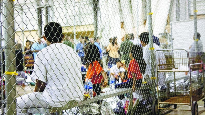FILE - In this June 17, 2018 file photo provided by U.S. Customs and Border Protection, people who've been taken into custody related to cases of illegal entry into the United States, sit in one of the cages at a facility in McAllen, Texas. The Trump administration is under increasing pressure to speed up the reunification of immigrant families it separated at the Mexican border. Attorneys for the U.S. government and the immigrant families discussed how to accelerate the process at a hearing Friday, Aug. 31, 2018, in San Diego in front of U.S. District Judge Dana Sabraw, who set the deadline. (U.S. Customs and Border Protection's Rio Grande Valley Sector via AP, File)