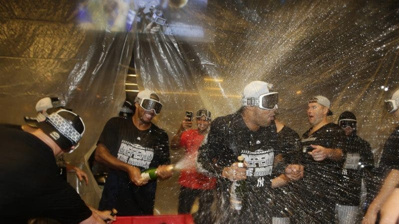 The New York Yankees celebrate after they clinched wildcard playoff birth with a 3-2 win over the Baltimore Orioles in a baseball game Saturday, Sept. 22, 2018, in New York. (AP Photo/Frank Franklin II)
